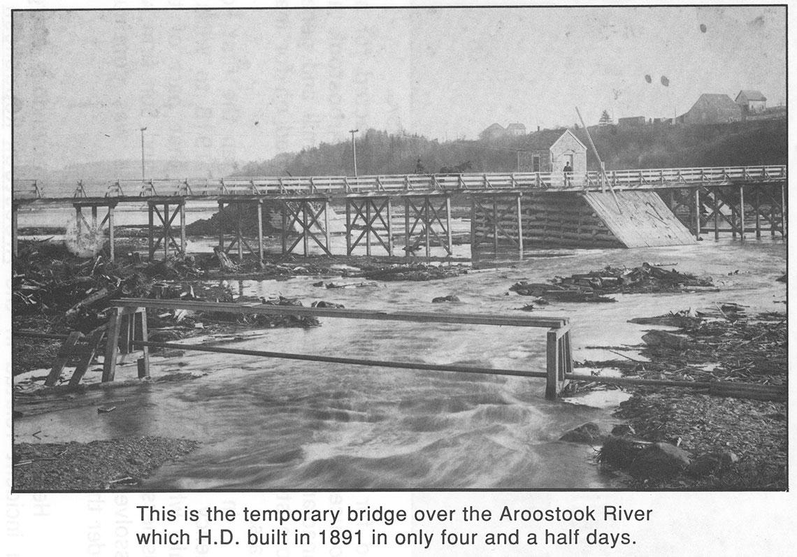 Temporary bridge over river photo